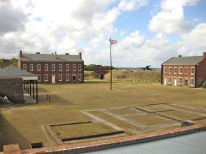 Fort Clinch Parade Ground showing the Barracks, Warehouse and Officer Quarters Foundations,  by John Stanton, Fort Wiki
