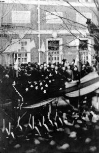 Abraham Lincoln raises a flag after admission of Kansas as a state