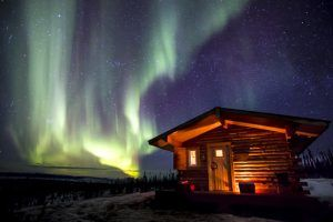 Northern Lights and Cabin on Steese Highway, Alaska by Bob Wick, Bureau of Land Management
