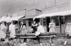Ladies and their cribs, Dawson, Yukon, Canada, about 1900