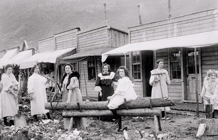 Ladies and their cribs, Dawson, Yukon, Canada, about 1900