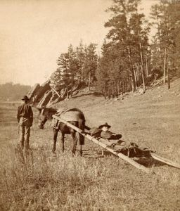Wounded Soldier on a Travois after the Slim Buttes Battle, by Stanley J. Morrow, 1876
