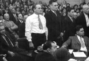 Albert Bates, in shirtsleeves, Harvey Bailey, Armon Shannon, and his father, Robert Shannon stand to be sentenced after they were found guilty.