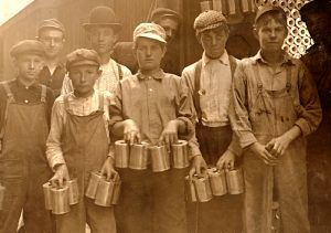 Boys working in a cannery in Indianapolis, Indiana, by Lewis Wickes Hine, 1908