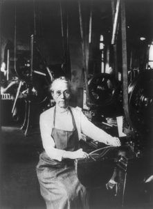 Woman operating a punch press,at the Frankford Arsenal, Frankford, Pennsylvania during World War I.