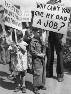 Children hold signs at a Great Depression protest against a factory owner in Columbus, Ohio, 1929