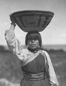 Basket Carrier at the San Juan Pueblo, New Mexico by Edward S. Curtis, 1905