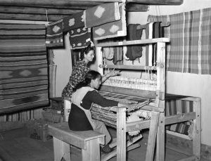 Spanish-American woman working for the WPA weaving a rag rug at Costilla, New Mexico by Russell Lee, 1939.