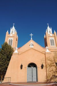 The San Felipe de Neri Church on the Old Town Plaza in Albuquerque, New Mexico was built in 1793. It is one of the oldest surviving buildings in the city and the only building in Old Town proven to date to the Spanish colonial period. By Kathy Weiser-Alexander.