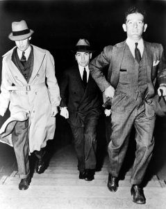 Lucky Luciano escorted to jail in New York, 1936