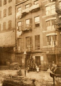 Tenement in New York City by Lewis W. Hine, 1910.