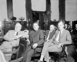 Teamsters in a Chicago Courtroom.Tim Murphy sitting at right, was a politician, union organizer, and reputed gangster. He was murdered in 1928.