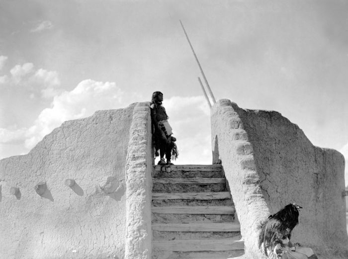 Tewa Indian guard at the top of the kiva stairs, San Ildefonso Pueblo, by Edward S. Curtis, 1905