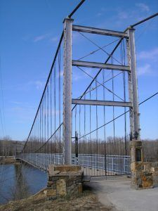 Swinging Bridge in Warsaw, Missouri by Kathy Weiser-Alexander.