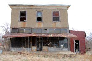 An old general store still stands in Carneiro, Kansas today, by Kathy Weiser-Alexander.