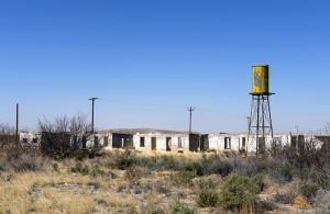 Abandoned buildings and water tower in Salt Flat, Texas by Carol Highsmith.