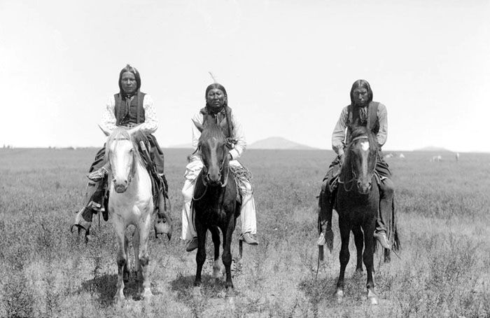 Three mounted Comanche warriors, 1892.