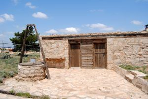 Weatherly Dugout Home Replica in Borger, Texas by Kathy Weiser-Alexander.