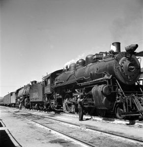 Atchison, Topeka, and Santa Fe Railroad in Kingman, Arizona by Jack Delano, 1943.