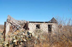 A collapsed stone building in Langtry, Texas by Kathy Weiser-Alexander.