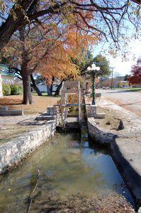 An ancient irrigation ditch in Menard, Texas by Kathy Weiser-Alexander.
