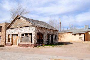 Old stone building in Peach Springs, Arizona by Kathy Weiser-Alexander.