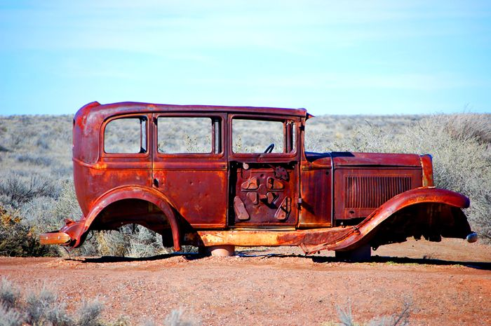 An old car in the Petrified Forest by Dave Alexander.