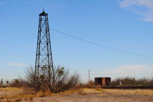 Water pump and tank in Pumpville, Texas by Kathy Weiser-Alexander.
