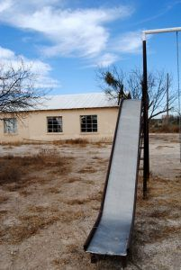 An old slide in front of the school in Pumpville, Texas by Kathy Weiser-Alexander.
