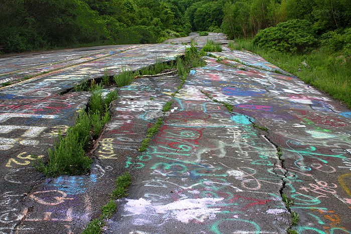 """Old Route 61 in Centralia, Pennsylvania is better known as """"Graffiti Highway"""" today, photo courtesy Wikipedia."""