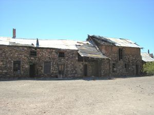 The Mine & Assay Office in Vulture, Arizona before restoration, by Kathy Weiser-Alexander.