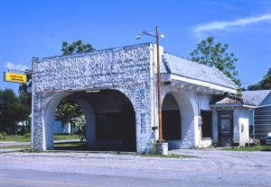 After the DX gas station went out of business, it became a liquore store. Photo by John Marolies, 1982.