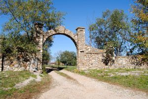 Rock Arch Entrance to Farm along route 66 east of Bourbon, Missouri by Kathy Weiser-Alexander.