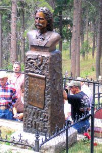 Wild Bill Hickok's grave in Deadwood, South Dakota by Kathy Weiser-Alexander