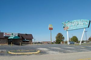 Tropics Restaurant and its iconic sign in Lincoln, Illinois by Kathy Weiwer-Alexander.