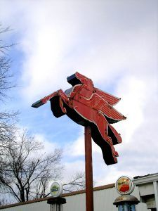 Mobil Pegasus sign at Route 66 Motors in Rolla, Missouri by Kathy Weiser-Alexander.