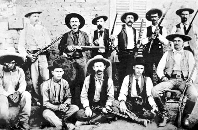 Company D of the Texas Rangers with John Hughes at lower right.
