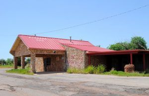 The old Pioneer BBQ on route 66 in Wellston, Oklahoma by Kathy Weiser-Alexander.
