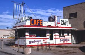 The Stork Cafe was an original Valentine's Diner in Winslow, Arizona, This 9-stool Valentine Diner was once located at at 114 East Third Street in Winslow, Arizona. Originally owned by Cecil McCormick and opened as the Birthplace Diner in about 1950. Through the years, it was called the Pit Diner, One Spot Grill, the Stork Cafe, and the Santa Fe Diner. Reports suggest that it was sold and moved to Oregon. Photo by John Margolies, 1979.