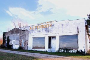 Jim Moot's Auto Body Shop is the only Route 66 era building left standing in Albatross, Missouri, by Kathy Weiser-Alexander.