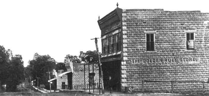 First phase of reconstruction after the 1909 fire shows reconstruction of McSpaden's golden Rule Store at right, Sinclair's Store in the middle and the Caledonia Bank at the end.