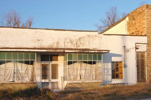 This building in Halltown, Missouri was built in 1906 and served several purposes through the years. It last housed Richard's Antiques but is vacant today. By Kathy Weiser-Alexander.