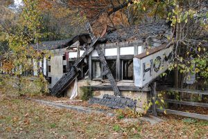 The old restaurant and bbuss station at the Stony Dell Resort are burned out and in ruins today, by Kathy Weiser- Alexander.