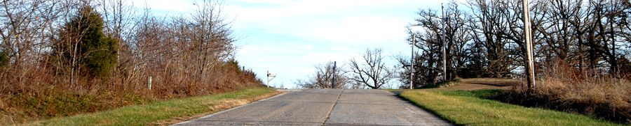 Straight line road of Route 66 west of Spencer, Missouri by Kathy Weiser-Alexander.