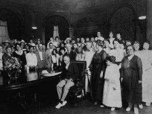 Governor Gardner signing resolution ratifying amendment to U.S. Constitution granting Women the right to vote by voteby Carl Deeg, 1919