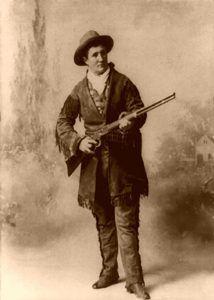 Calamity Jane holding a gun in 1895.