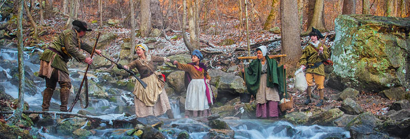 Pioneer Re-enactors crossing a creek in Cumberland Gap National Park, by the National Park Service.