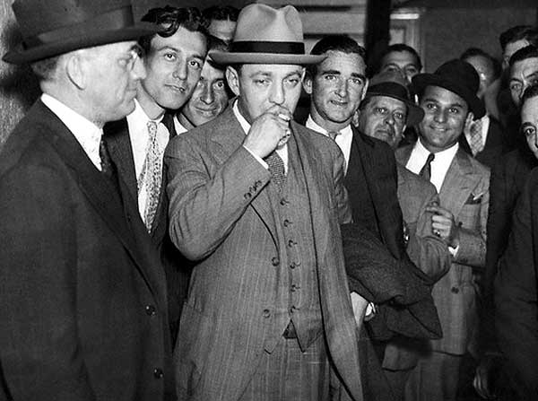 Dutch Schultz smoking outside the New York Federal Courthouse, 1935.