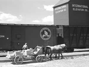 Loading freight in Homestead, Montana by Marion Post Woolcott, 1941