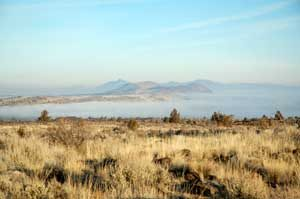 Fog shrouded Tule Lake at the Lava Beds National Monument in California by the National Park Service.
